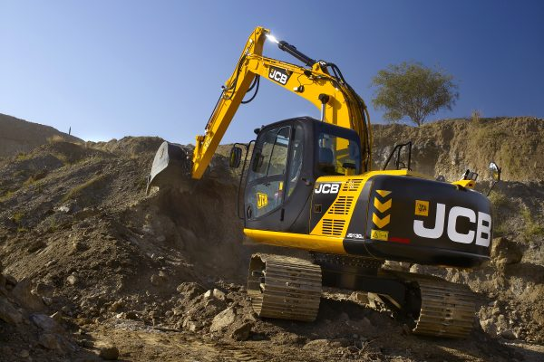 JCB tracked excavator digging earth from a large hole