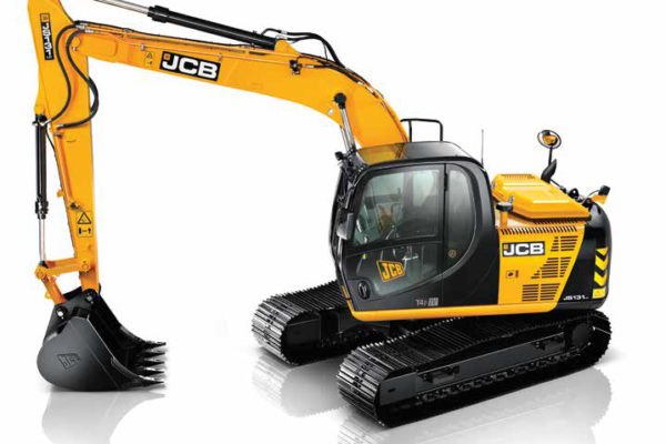 Large JCB excavator with a bucket attachment resting on the floor